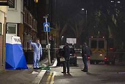 © Licensed to London News Pictures.22/02/2021. London, UK. Police guard a crime scene afer fatal stabbing in Tottenham, north London. Police were called at 4pm to reports of a man believed aged in his 20s, stabbed in West Green Road. Despite the efforts of the emergency services the man was pronounced dead at the scene. Photo credit: Marcin Nowak/LNP