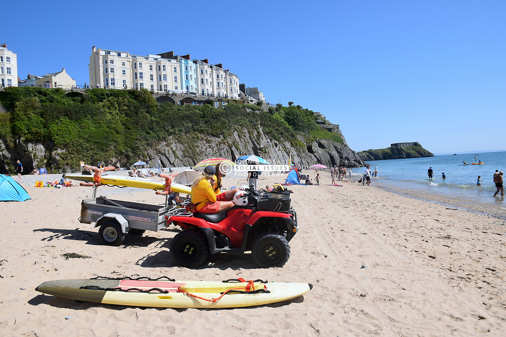 Lifeguards on South Beach, Tenby, Pembrokeshire South Wales, July 2021