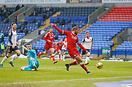 Crawley Town's George Francomb hits the post after going past Bolton Wanderers goalkeeper Matthew Gilks(13) during the EFL Sky Bet League 2 match between Bolton Wanderers and Crawley Town at the University of  Bolton Stadium, Bolton, England on 2 January 2021.