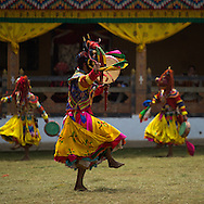Dancers at the Talo Tshechu, a three day festival in the mountains above Punakha, Bhutan, 2014