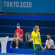 TOKYO, JAPAN - JULY 28: Ariarne Titmus of Australia is overcome with emotion as she is congratulated by <br /> coach Dean Boxall after winning the gold medal in the 200m freestyle for women during the Swimming Finals at the Tokyo Aquatic Centre at the Tokyo 2020 Summer Olympic Games on July 28, 2021 in Tokyo, Japan. (Photo by Tim Clayton/Corbis via Getty Images)