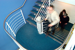 Staff using stairs in office UK