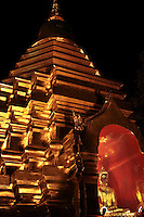 Golden chedi is illuminated at night at Wat Sareerikatart Sirirak in Chiang Mai's old city.