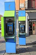 Telephone kiosk boxes in street, La Latina, Madrid city centre, Spain