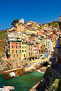 Photo of the colorful houses of the fishing port of Riomaggiore, Cinque Terre National Park, Liguria, Italy .<br /> <br /> Visit our ITALY HISTORIC PLACES PHOTO COLLECTION for more   photos of Italy to download or buy as prints https://funkystock.photoshelter.com/gallery-collection/2b-Pictures-Images-of-Italy-Photos-of-Italian-Historic-Landmark-Sites/C0000qxA2zGFjd_k