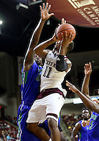 Texas A&M's Anthony Collins (11) drives the lane for a basket against Florida Gulf Coast University's Antravious Simmons (32) during a NCAA college basketball game in College Station, Texas, Wednesday, Dec. 2, 2015.  (AP Photo/Sam Craft)