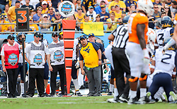 Sep 1, 2018; Charlotte, NC, USA; West Virginia Mountaineers defensive coordinator Tony Gibson leans towards the first down marker during the second quarter against the Tennessee Volunteers at Bank of America Stadium. Mandatory Credit: Ben Queen-USA TODAY Sports