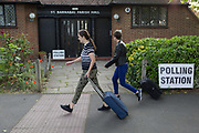 Before voting for the European Elections commences at 7am, local people walk past the entrance of the Polling Station at St. Barnabas Parish Hall in Dulwich Village, on 23rd May 2019, in south London, England UK.
