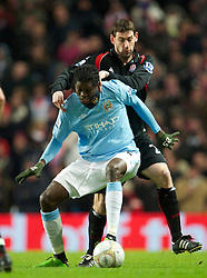 MANCHESTER, ENGLAND - Sunday, February 13, 2010: Manchester City's Emmanuel Adebayor and Stoke City's Rory Delap during the FA Cup 5th Round match at the City of Manchester Stadium. (Photo by David Rawcliffe/Propaganda)  MANCHESTER, ENGLAND - Sunday, February 13, 2010: Manchester City xxxx and Stoke City's xxxx during the FA Cup 5th Round match at the City of Manchester Stadium. (Photo by David Rawcliffe/Propaganda)