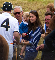 © Licensed to London News Pictures. 14/06/2015. Prince George of Cambridge and his mother Catherine, Duchess of Cambridge talking to Prince Willam (Far left) and Prince Charles (Second left) . British Royals attend a charity Polo match in Tetbury,  Gloucestershire, UK. Photo credit: Ben Cawthra/LNP