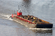 Highland, N.Y. - The tugboat Cheyenne pushes the barge Veronica Evelyn down the Hudson River between Highland and Poughkeepsie on July 8, 2006. ©Tom Bushey