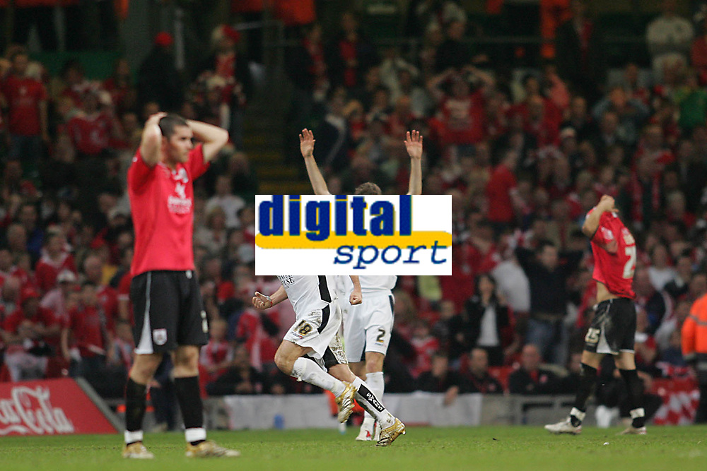 Photo: Lee Earle.<br /> Barnsley v Swansea City. Coca Cola League 1. Play off Final. 27/05/2006. Swansea's Andy Robinson (2ndL) celebrates his deflected shot going in as the Barnsley players look dejected.