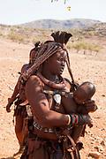 Himba woman in a Himba village, Kaokoveld, Namibia, Africa