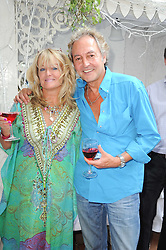 """ROD WESTON and AMANDA BRANDLER at a party to celebrate the publication of the Paper back edition of """"A Lion Called Christian"""" held at Julie's Restaurant & Bar, 135 Portland Road, London W11 on 28th June 2010."""