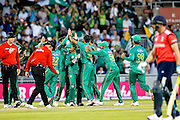 Pakistan celebrate as another England wicket goes during the International T20 match between England and Pakistan at the Emirates, Old Trafford, Manchester, United Kingdom on 7 September 2016. Photo by Craig Galloway.