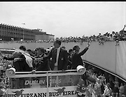 Irish Soccer Team Welcomed Home.   (R81)..1988..19.06.1988..06.19.1988..19th June 1988..After their great success in Germany in Euro 88, the Irish soccer team had a triumphant homecoming. An Taoiseach, Charles Haughey TD and his government were to the forefront of the welcome. Thousands of fans thronged the airport and all the approach roads in the hope of seeing the team. The full squad is as follows..1.GK.Packie Bonner. Celtic.2.DF.Chris Morris. Celtic.3.DF.Chris Hughton  Tottenham Hotspur.4.DF.Mick McCarthy. Celtic.5.DF.Kevin Moran. Manchester United.6.MF.Ronnie Whelan. Liverpool.7.MF.Paul McGrath. Manchester United.8.MF.Ray Houghton. Liverpool.9.FW.John Aldridge. Liverpool.10.FW.Frank Stapleton Derby County.11.MF.Tony Galvin. Sheffield Wednesday.12.FW.Tony Cascarino. Millwall.13.MF.Liam O'Brien. Manchester United.14.FW.David Kelly. Walsall.15.MF.Kevin Sheedy. Everton.16.GK.Gerry Peyton. Bournemouth.17.FW.John Byrne. Le Havre.18.FW.John Sheridan. Leeds United.19.DF.John Anderson. Newcastle United.20.FW.Niall Quinn. Arsenal..Maurice Setters waves the Tricolour to a delighted crowd as the bus sets off for Dublin City centre.