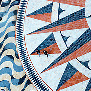 Aerial view of people walking over giant compass rose at Lisbon's Belém area