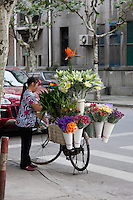 Flower seller with bike in Shanghai China