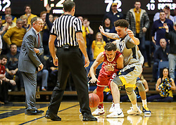 Jan 6, 2018; Morgantown, WV, USA; West Virginia Mountaineers forward Teddy Allen (13) defends Oklahoma Sooners guard Trae Young (11) during the second half at WVU Coliseum. Mandatory Credit: Ben Queen-USA TODAY Sports