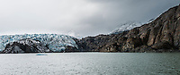 Glacier Grey creeps over rock in Torres del Paine National Park, Chile.
