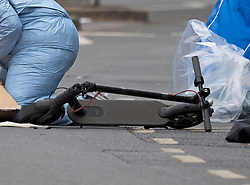 © Licensed to London News Pictures. 08/06/2020. London, UK. An electric scooter, at the scene on Askew Road in Shepherd's Bush, west London where a man in his 20's was shot dead in the early hours of this morning. Photo credit: Ben Cawthra/LNP