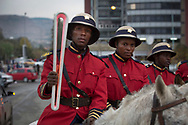 The Queen's Baton arrived in Lesotho on 11 May, 2017, on the first of four days in the country, where it was welcomed welcomed to the mountain kingdom by King Letsie III of Lesotho. This Queen's Baton Relay will visit all 70 nations and territories of the Commonwealth, over 388 days and cover 230,000km. It will be the longest Relay in Commonwealth Games history, finishing at the Opening Ceremony on the Gold Coast on 4th April 2018. Photograph shows mounted police carrying the Baton as it arrived in the country's capital Maseru where it was presented to King Letsie III of Lesotho.