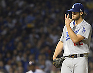 CHICAGO, IL - OCTOBER 16:  Clayton Kershaw #22 of the Los Angeles Dodgers motions toward Yasmani Grandal #9 during Game 2 of NLCS against the Chicago Cubs at Wrigley Field on Sunday, October 16, 2016 in Chicago, Illinois. (Photo by Ron Vesely/MLB Photos via Getty Images) *** Local Caption *** Clayton Kershaw; Yasmani Grandal