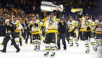 NASHVILLE, TN - JUNE 11:  Sidney Crosby #87 of the Pittsburgh Penguins and his teammates celebrate with the Stanley Cup trophy after defeating the Nashville Predators 2-0 in Game Six of the 2017 NHL Stanley Cup Final at the Bridgestone Arena on June 11, 2017 in Nashville, Tennessee.  (Photo by Frederick Breedon/Getty Images)
