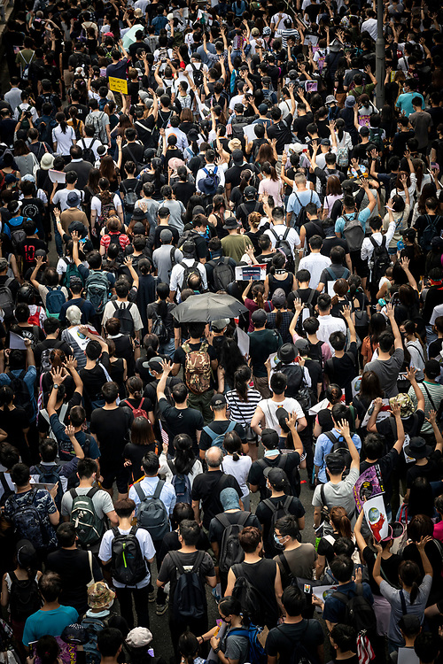 A large crowd of demonstrators march from Chater Garden toward the U.S. consulate in Hong Kong. The protest this day was directed toward encouraging the United States to support the Hong Kong Human Rights and Democracy Act, which would require the U.S. government to assess Hong Kong's level of political autonomy to determine whether it should continue to have a special trade status under the U.S.-Hong Kong Policy Act of 1992.<br /> (August 31, 2019)