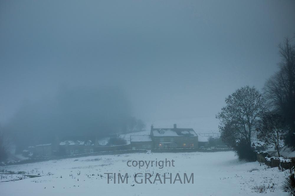 Foggy scene in the village of Swinbrook,  The Cotswolds, UK