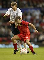Photo: Aidan Ellis.<br /> England v Andorra. European Championships 2008 Qualifying. 02/09/2006.<br /> England's Steven Gerrard looks to nick the ball from Andorra's Julia Sanchez