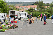 outdoors farmers market food shoppers keeping a social distance during Covid 19 crisis France Limoux April 2020