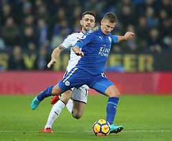 Leicester City's Marc Albrighton and Burnley's Robbie Brady battle for the ball