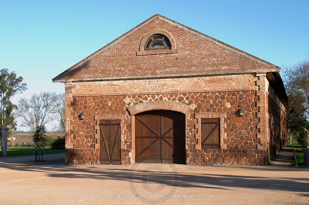One of the vineyard buildings built in brick and stone. Bodega Juanico Familia Deicas Winery, Juanico, Canelones, Uruguay, South America