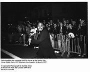 Cuba Gooding Jnr. running with his Oscar at the Vanity Fair Oscar Night Party. 1997 Mortons, Los Angeles 24 March 1997<br /> © Copyright Photograph by Dafydd Jones<br /> 66 Stockwell Park Rd. London SW9 0DA<br /> Tel 0171 733 0108