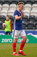 An apologetic Ciaran Dickson (Rangers FC) leaves the park following his red card during the U17 European Championships match between Scotland and Russia at Simple Digital Arena, Paisley, Scotland on 23 March 2019.