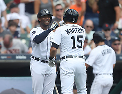 August 10, 2017 - Detroit, MI, USA - The Detroit Tigers' Justin Upton meets  Mikie Mahtook (15) at home plate after his solo home run against the Pittsburgh Pirates in the third inning on Thursday, Aug. 10, 2017, at Comerica Park in Detroit. The Pirates won, 7-5. (Credit Image: © Kirthmon F. Dozier/TNS via ZUMA Wire)