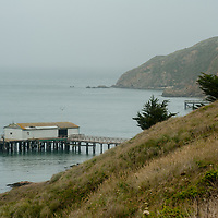 Piers reach into the Pacific Ocean at the historic Point Reyes Lifeboat Station at Point Reyes National Seashore in California.