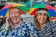 The rains come down again but generally fail to dampen the spirits - The 2016 Glastonbury Festival, Worthy Farm, Glastonbury.
