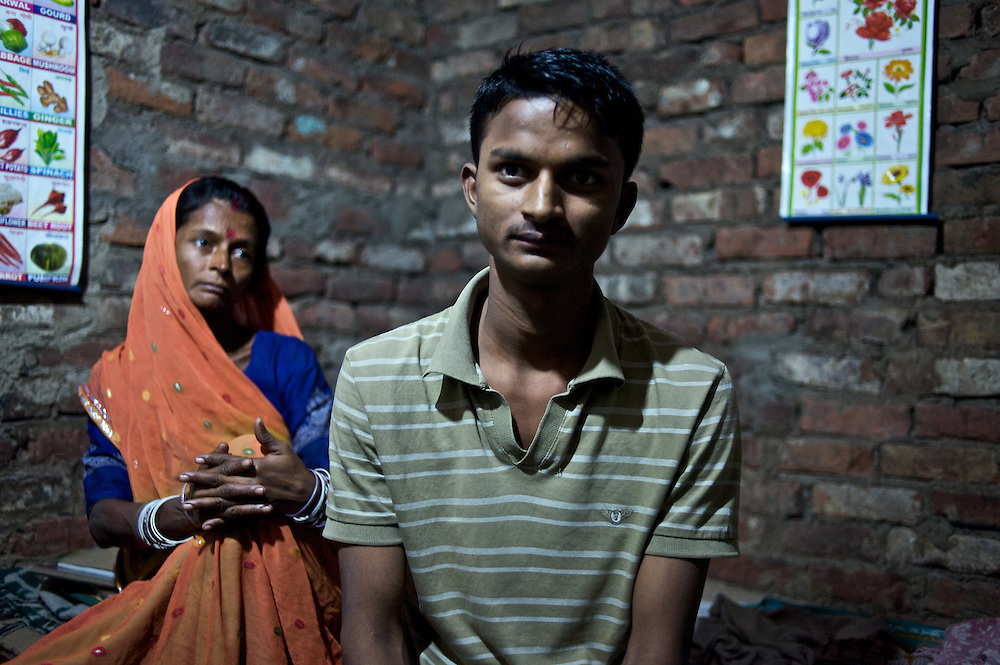 A mother and her son in the neighborhood of Madanpur Khadar in Delhi, India.