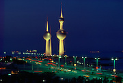 Night-time in Kuwait. Floodlit Kuwaiti Towers tower over the city streets. RESERVED USE - NOT FOR DOWNLOAD -  FOR USE CONTACT TIM GRAHAM