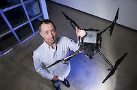 Cheetah Logistics chief technology officer Edan Cain holds a Matrice drone equipped with sonar and 3d cameras in Westlake Village, CA.  Feb. 25,  2016.   Photo by David Sprague
