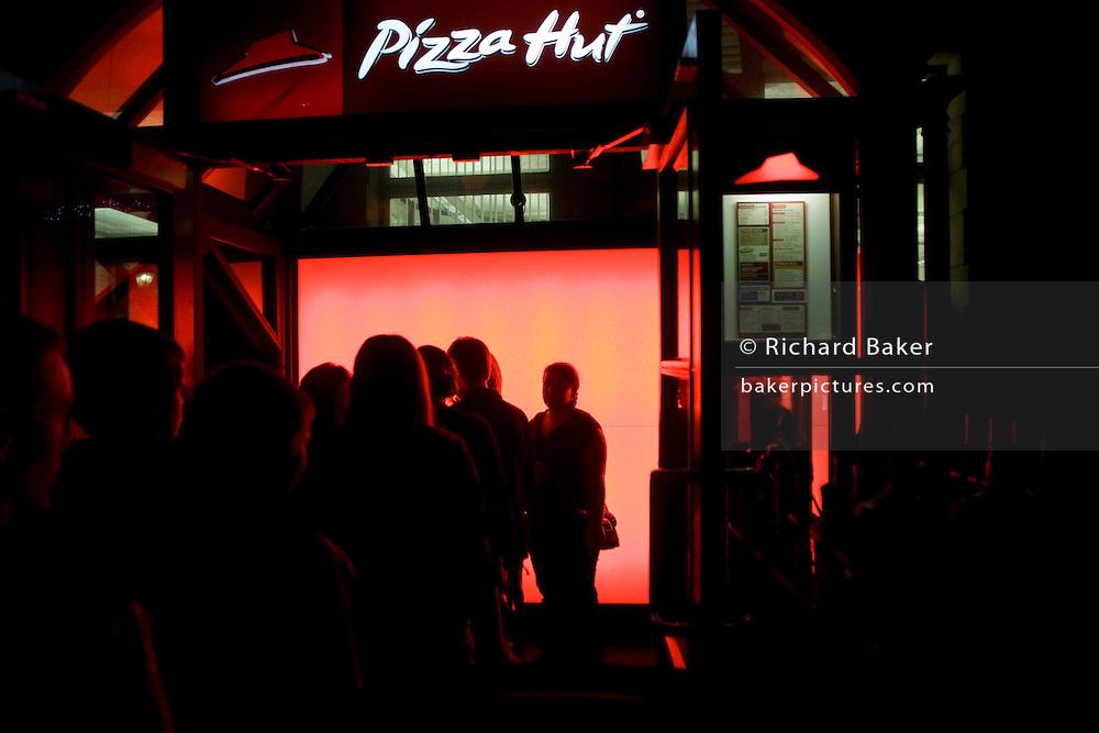 Customers queue to gain entrance into London Pizza Hut restaurant.