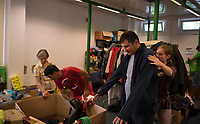 DEU, Deutschland, Germany, Berlin, 17.08.2015: Eine freiwillige Helferin hilft einem Flüchtling bei der Anprobe einer Jacke in der Kleiderkammer der kurzfristig eingerichteten Notunterkunft im Berliner Stadtteil Karlshorst. Die vom DRK betriebene Erstaufnahmestelle in der Köpenicker Allee soll die Zentrale Aufnahmeeinrichtung für Asylbewerber der LaGeSo in Moabit entlasten.