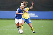 Brighton & Hove Albion forward Kayleigh Green (15)  tackles Everton midfielder Issy Christiansen (8) during the FA Women's Super League match between Everton Women and Brighton and Hove Albion Women at the Select Security Stadium, Halton, United Kingdom on 18 October 2020.