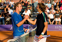 Grega Zemlja of Slovenia congrats to Paolo Lorenzi of Italy after winning during the final match during day seven of the ATP Challenger Tour BMW Ljubljana Open 2011, on September 25, 2011, in TC Ljubljana Siska, Slovenia. (Photo by Vid Ponikvar / Sportida)