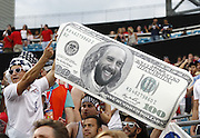JACKSONVILLE, FL - JUNE 07:  A fan holds a sign depicting goalie Tim Howard #1 of the United States as Benjamin Franklin on a $100 bill to commemorate Howard's 100th cap during the international friendly match against Nigeria at EverBank Field on June 7, 2014 in Jacksonville, Florida.  (Photo by Mike Zarrilli/Getty Images)