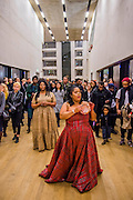 Aluminum - New York-based choreographer Rashida Bumbray  (pictured red dress)  collaborates with Simone Leigh (pictured beige dress) on an immersive danceperformance. The performance begins in the Tanks at and proceeds through the Switch House, pausing on Level 4 around and concluding in Tate Exchange. London 26 Nov 2016.