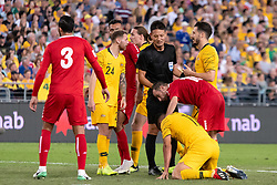 November 20, 2018 - Sydney, NSW, U.S. - SYDNEY, AUSTRALIA - NOVEMBER 20: Australian forward Andrew Nabbout (11) stays down after a hit from Lebanon player Walid Ismail (18) at the international soccer match between Australia and Lebanon on November 20, 2018, at ANZ Stadium in NSW, Australia. (Photo by Speed Media/Icon Sportswire) (Credit Image: © Speed Media/Icon SMI via ZUMA Press)