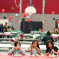 042513       Brian Leddy<br /> Crownpoint Elementary fifth-graders Kiersten Tsosie, Naveaha Sloan and Ramona Andis eat lunch in their new school Thursday afternoon. The Gallup-McKinley County school opened it's doors two weeks ago.